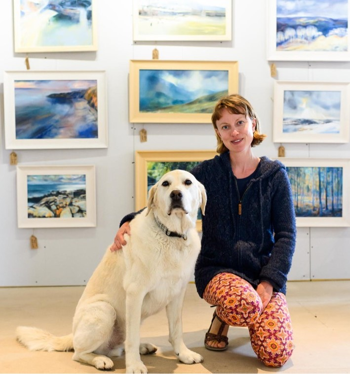 Janet and Ashby in front of paintings