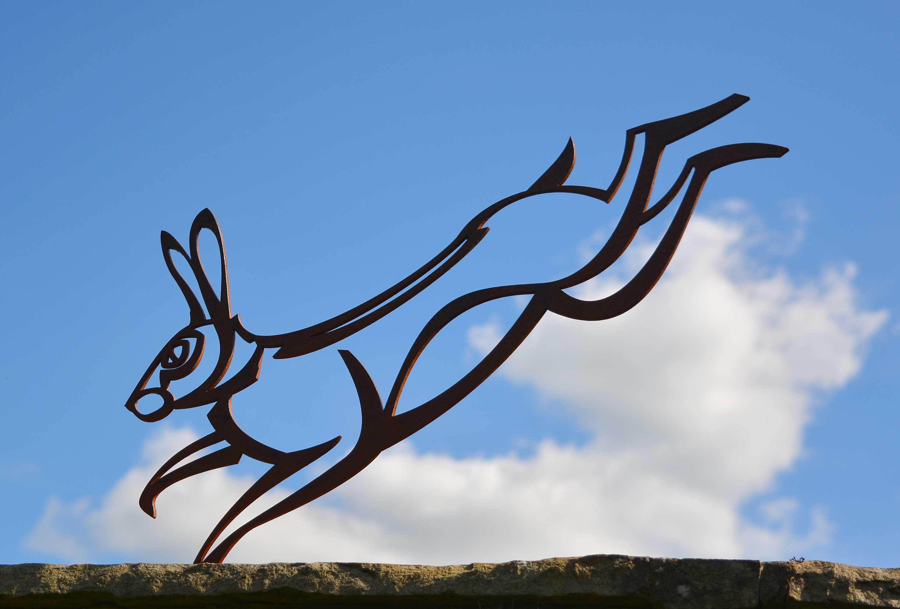 Hare sculpture against blue sky